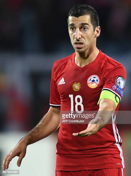 Armenia's midfielder Henrikh Mkhitaryan reacts during the FIFA World Cup 2018 qualification football match between Armenia and Poland in Yerevan on...