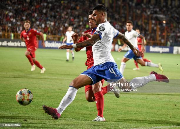 Armenia's midfielder Rumyan Hovsepyan fights for the ball with Italy's defender Emerson Palmieri during the Euro 2020 Group J football qualification...