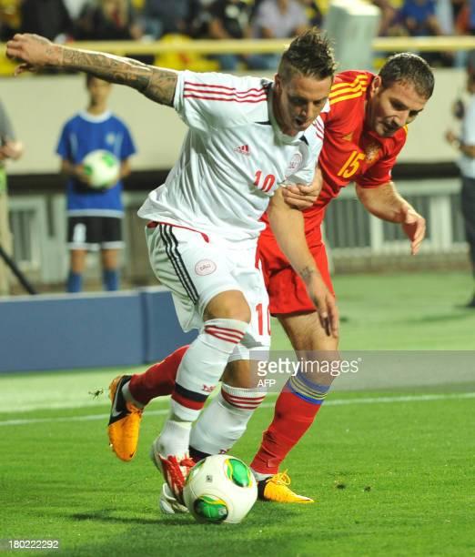 Armenia's national football team defender Hrayr Mkoyan vies with Denmark's national football team forward Nicki Nielsen during their FIFA 2014 World...