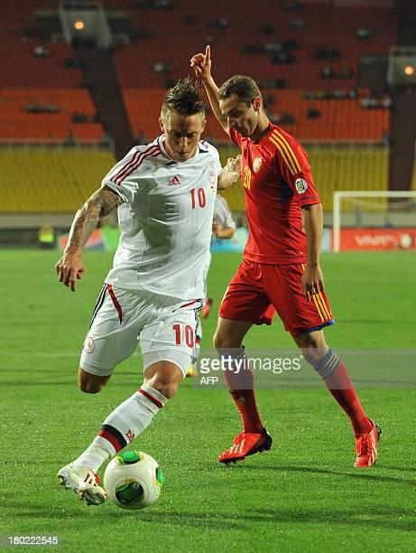 Armenia's national football team defender Levon Hayrapetyan vies with Denmark's national football team forward Nicki Nielsen during their FIFA 2014...