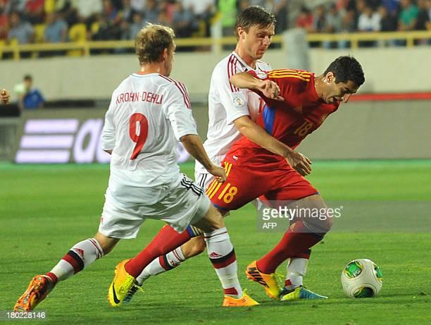 Armenia's national football team midfielder Henrikh Mkhitaryan vies with Denmark's national football team midfielder Michael KrohnDehli and forward...