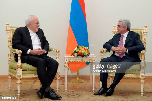 Armenia's President Serzh Sargsyan meets with Iranian Foreign Minister Mohammad Javad Zarif in Yerevan on November 28 2017 / AFP PHOTO / Karen...