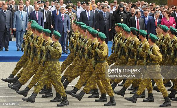 Armenia's President Serzh Sargsyan watches soldiers marching through the capital Yerevan during a Republic Day parade on May 28 2015 AFP PHOTO /...
