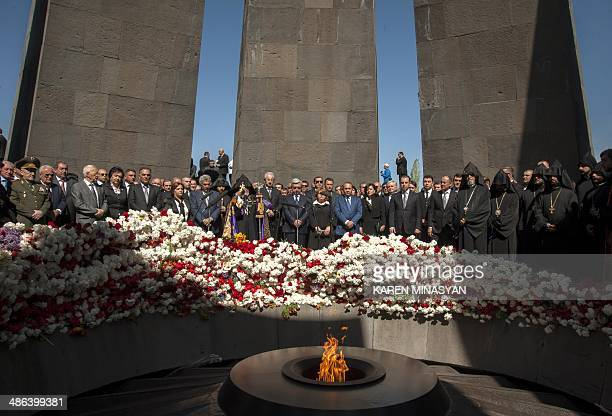Armenia's President Serzh Sarkisian Armenian Apostolic Church leader Catholicos Garegin II and top officials lay flowers at the monument to Armenians...
