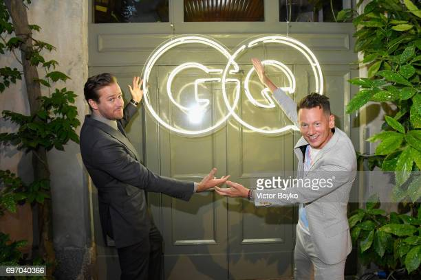 Armie Hammer and Jim Nelson attends GQ Celebrates Milan Men's Fashion Week during Milan Men's Fashion Week Spring/Summer 2018 on June 17 2017 in...