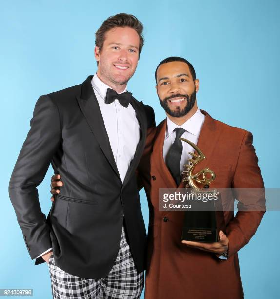 Armie Hammer and Omari Hardwick pose backstage with his award during the 2018 American Black Film Festival Honors Awards at The Beverly Hilton Hotel...