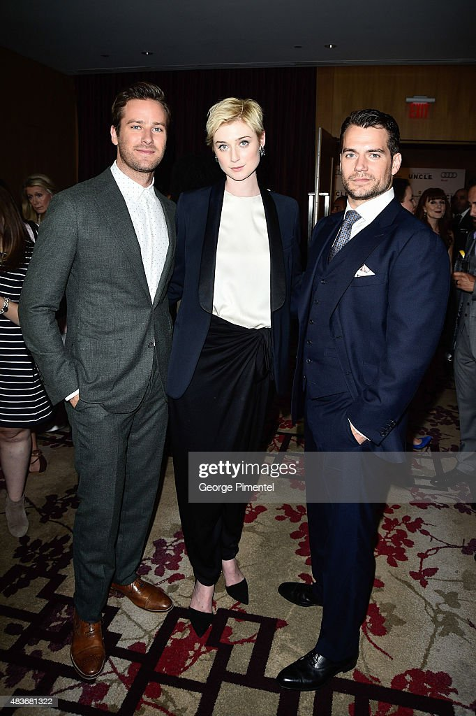 Armie Hammer, Elizabeth Debicki and Henry Cavill attend Warner Bros. Pictures Canada and Audi Canada host a private cocktail reception for the Canadian premiere of 'The Man From U.N.C.L.E.' at Shangri-La Hotel on August 11, 2015 in Toronto, Canada.