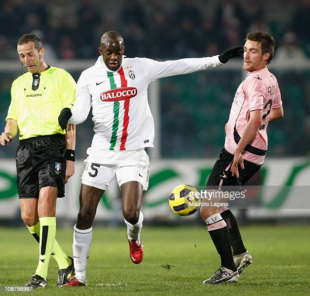 Armin Bacinovic of Palermo battles for the ball with Mohamed Sissoko of Juventus during the Serie A match between US Citta di Palermo and Juventus FC...