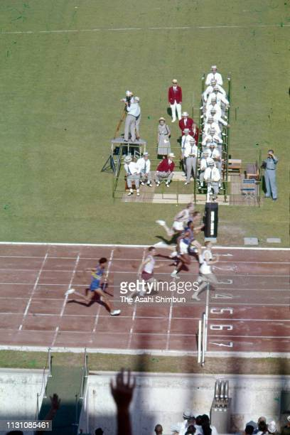Armin Hary of Germany crosses the finish line in the Men's 100m Semi Final of the Rome Olympic Games at the Stadio Olimpico on August 31 1960 in Rome...