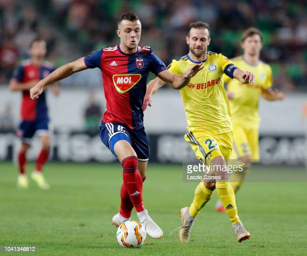 Armin Hodzic of Vidi FC competes for the ball with Igor Stasevich of FC BATE Borsiov during the UEFA Europa League Group Stage match between Vidi FC...
