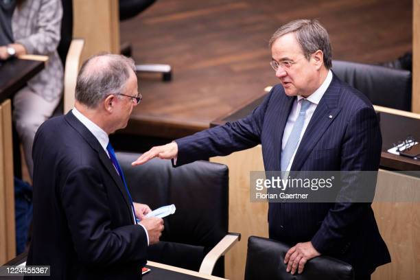 Armin Laschet CDU prime minister of the German state of North RhineWestphalia and Stephan Weil SPD prime minister of the German state of Lower Saxony...