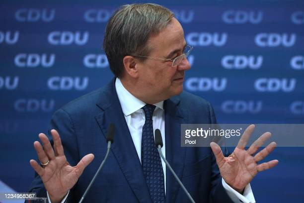 """Armin Laschet, chancellor candidate of the German Christian Democrats , speaks to the media the day after the first of three """"triell"""" television..."""