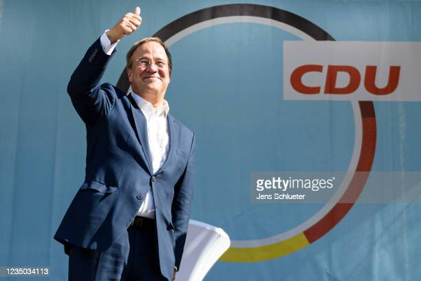 Armin Laschet , chancellor candidate of the German Christian Democrats , greets supporters as he campaigns on September 3, 2021 in Apolda, Germany....
