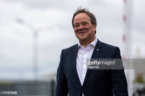 Armin Laschet Deputy coChairman of the German Christian Democrats and Governor of North RhineWestphalia arrives to try out the new eGO Life electric...