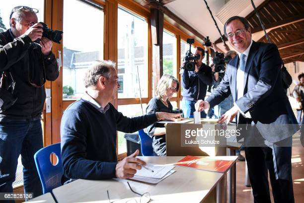 Armin Laschet, lead candidate of the German Christian Democrats , casts his ballot in state elections in North Rhine-Westphalia on May 14, 2017 in...
