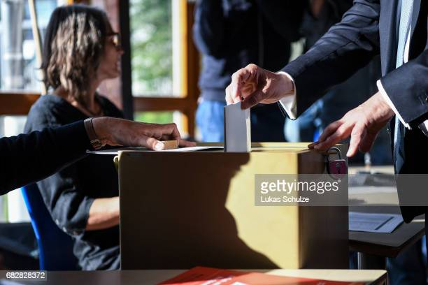 Armin Laschet lead candidate of the German Christian Democrats casts his ballot in state elections in North RhineWestphalia on May 14 2017 in Aachen...