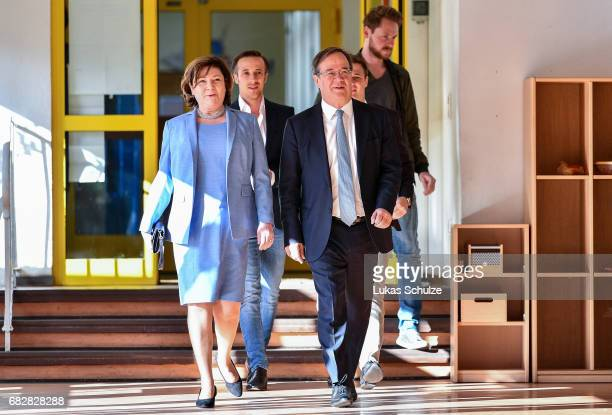 Armin Laschet, lead candidate of the German Christian Democrats arrives with his wife Susanne Laschet to casts his ballot in state elections in North...
