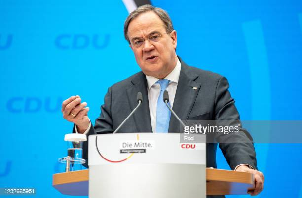 Armin Laschet, leader and chancellor candidate of the German Christian Democrats , speaks to the media during a press conference following a virtual...