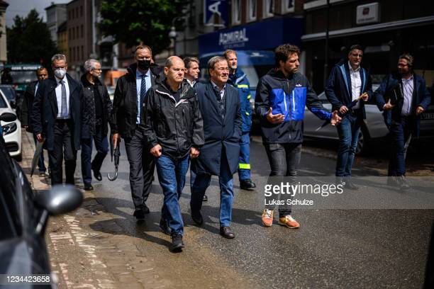 Armin Laschet , premier of North Rhine-Westphalia and chancellor candidate of the German Christian Democrats , and Olaf Scholz , federal finance...