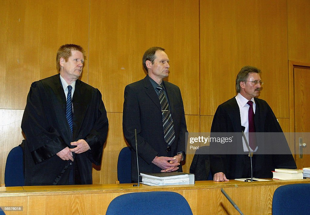 Armin Meiwes (C) and his lawyer Harald Ermel (L) attends his retrial on January 12, 2006 at the District Court in Frankfurt, Germany. Meiwes was convicted two years ago of killing and eating an apparently willing victim.