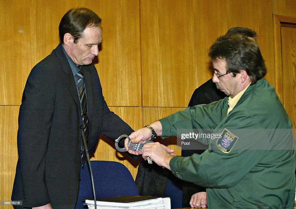 Armin Meiwes gets his handcuffs removed as he attend his retrial on January 12, 2006 at the District Court in Frankfurt, Germany. Meiwes was convicted two years ago of killing and eating an apparently willing victim.
