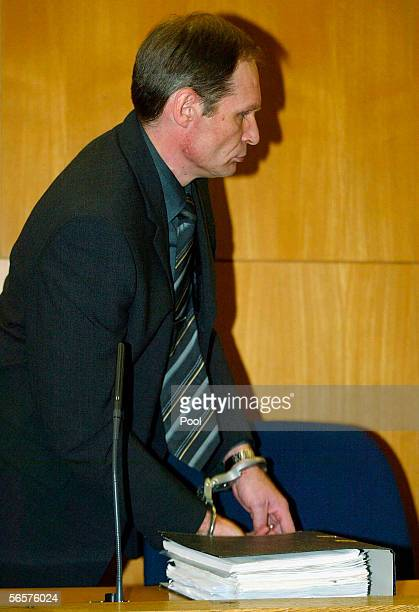 Armin Meiwes in handcuffs attend his retrial on January 12 2006 at the District Court in Frankfurt Germany Meiwes was convicted two years ago of...
