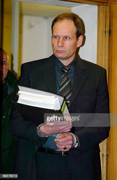 Armin Meiwes in handcuffs attends his retrial on January 12 2006 at the District Court in Frankfurt Germany Meiwes was convicted two years ago of...