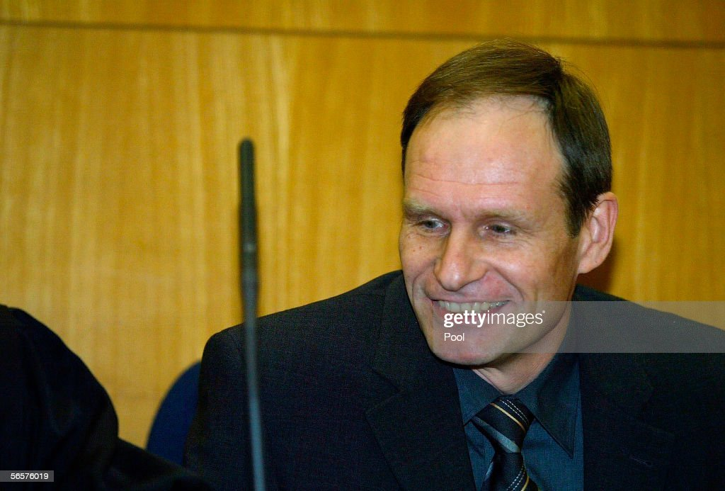 Armin Meiwes smiles as he attend his retrial on January 12, 2006 at the District Court in Frankfurt, Germany. Meiwes was convicted two years ago of killing and eating an apparently willing victim.