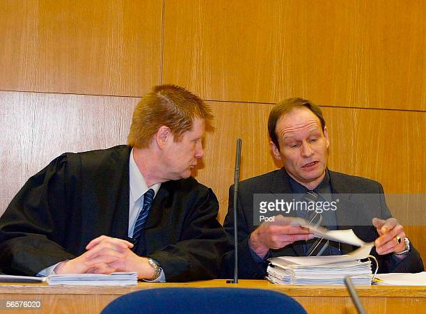Armin Meiwes talsk to his lawyer Harald Ermel as they attend his retrial on January 12 2006 at the District Court in Frankfurt Germany Meiwes was...