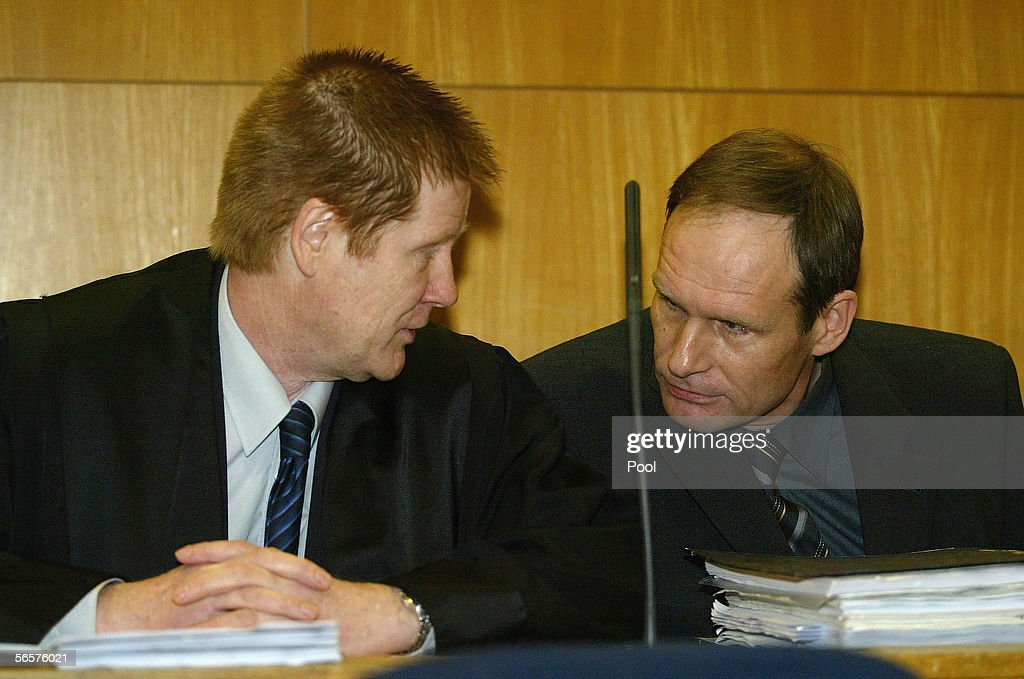 Armin Meiwes (R) talsk to his lawyer Harald Ermel (L) as they attend his retrial on January 12, 2006 at the District Court in Frankfurt, Germany. Meiwes was convicted two years ago of killing and eating an apparently willing victim.