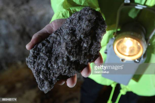 Armin Mueller CEO of Deutsche Lithium GmbH holds a rock of Zinnwaldite a silicate mineral that contains lithium hewn from a passage in a former tin...