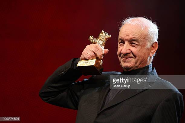 Armin MuellerStahl holds the Golden Honorary Bear at the 'Music Box' Premiere during day nine of the 61st Berlin International Film Festival at...