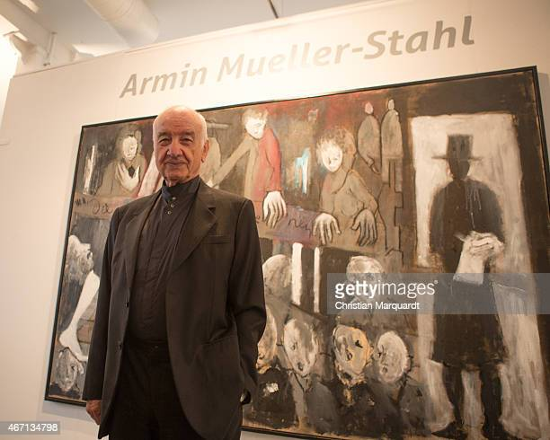 Armin MuellerStahl stands next to his work during the opening of 'Menschenbilder' exhibition preview at Kunsthalle Brennabor on March 21 2015 in...