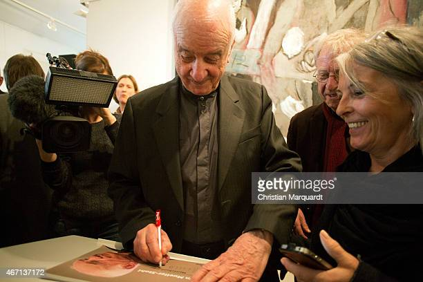 Armin MuellerStahl writes autograph cards during the opening of 'Menschenbilder' exhibition preview at Kunsthalle Brennabor on March 21 2015 in...