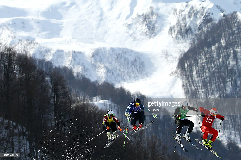 Armin Niederer (R) of Switzeland leads during the Freestyle Skiing Men's Ski Cross 1/8 Finals on day 13 of the 2014 Sochi Winter Olympic at Rosa Khutor Extreme Park on February 20, 2014 in Sochi, Russia.