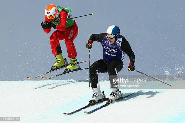 Armin Niederer of Switzerland and Jouni Pellinen of Finland compete during the Freestyle Skiing Men's Ski Cross 1/8 Finals on day 13 of the 2014...