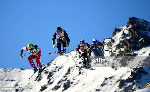 Armin Niederer of Swizterland Sweeden Viktort Andersson Canada's Kristofor Mahler and Canada's Kevi Drury compete during the FIS men'squarterfinal...