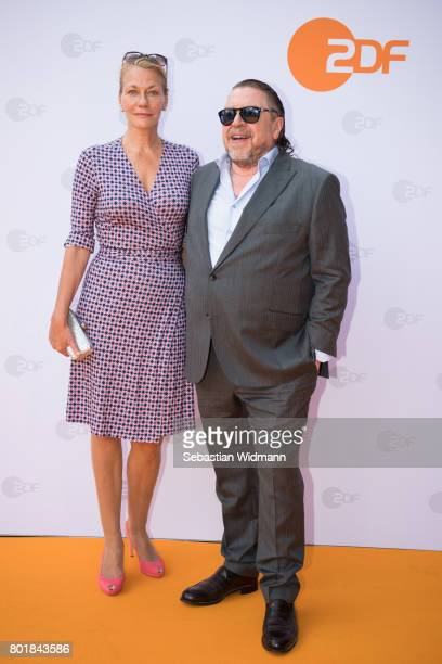 Armin Rohde and his girlfriend and manager Karen Boehne arrive at the ZDF reception during the Munich Film Festival at Hugo's on June 27 2017 in...