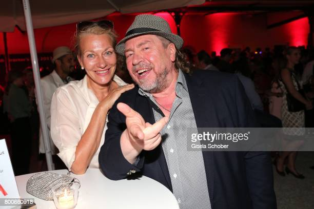 Armin Rohde and his girlfriend and manager Karen Boehne during the 'Audi Director's cut' Party during the Munich film festival at Praterinsel on June...