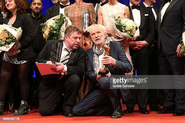 Armin Rohde and Michael Gwisdeck with award during the Hessian Film and Cinema Award 2015 at Alte Oper on October 16 2015 in Frankfurt am Main Germany