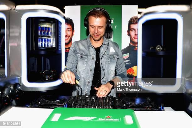 Armin van Buuren performs a DJ set for Heineken in the Red Bull Racing garage before the Formula One Grand Prix of China at Shanghai International...