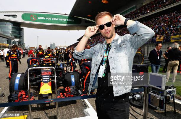 Armin van Buuren poses for a photo with the car of Max Verstappen of Netherlands and Red Bull Racing on the grid before the Formula One Grand Prix of...