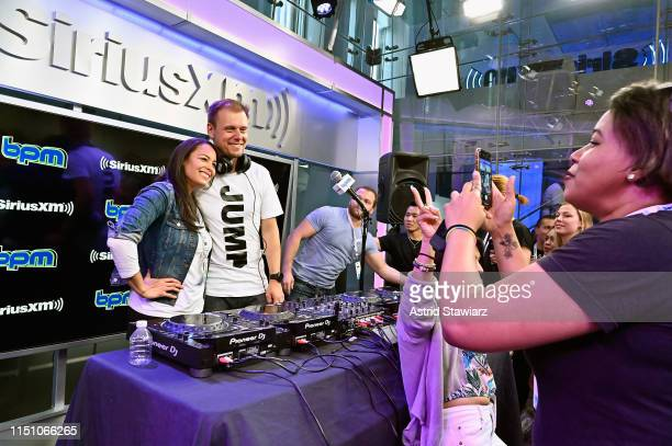 Armin van Buuren poses for selfies with fans during a peformance on SiriusXM's BPM channel at the SiriusXM Studios In New York City at SiriusXM...