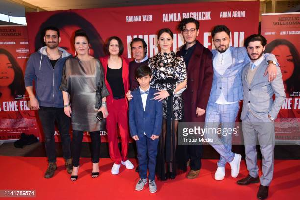 Armin Wahedi, Aram Arami, Meral Perin, Merve Aksoy, Almila Bagriacik and Rauand Taleb attend the 'Nur eine Frau' premiere at Kino International movie...