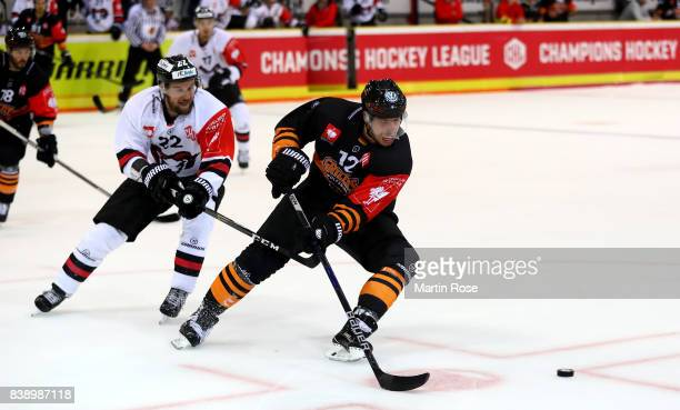Armin Wurm of Wolfsburg and Matej Cesik of Bystrica battle for the puck during the Champions Hockey League match between Grizzlys Wolfsburg and HC05...