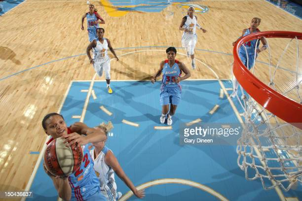 Arminte Price of the Atlanta Dream goes to the basket past Courtney Vandersloot of the Chicago Sky on August 17 2012 at the Allstate Arena in...