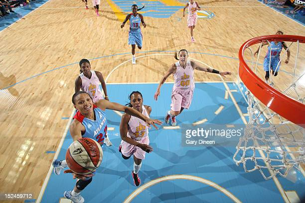 Arminte Price of the Atlanta Dream goes to the basket past Shay Murphy Le'coe Willingham and Ruth Riley of the Chicago Sky on September 20 2012 at...