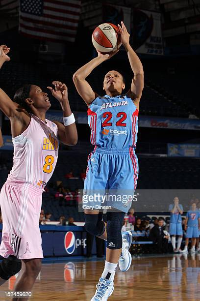 Arminte Price of the Atlanta Dream shoots past Swin Cash of the Chicago Sky on September 20 2012 at the Allstate Arena in Rosemont Illinois NOTE TO...
