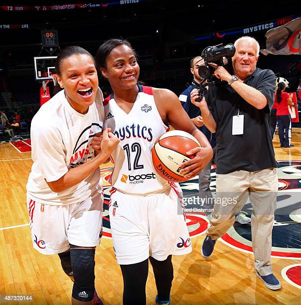 Armintie Herrington and Ivory Latta of the Washington Mystics celebrate after the game against the Indiana Fever on September 8 2015 at the Verizon...