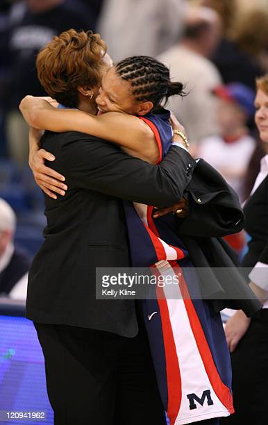 Armintie Price hugs assistant coach Peggy GillonPrice lead the Rebels and all scorers with 29 points in the upset during the second round of the NCAA...